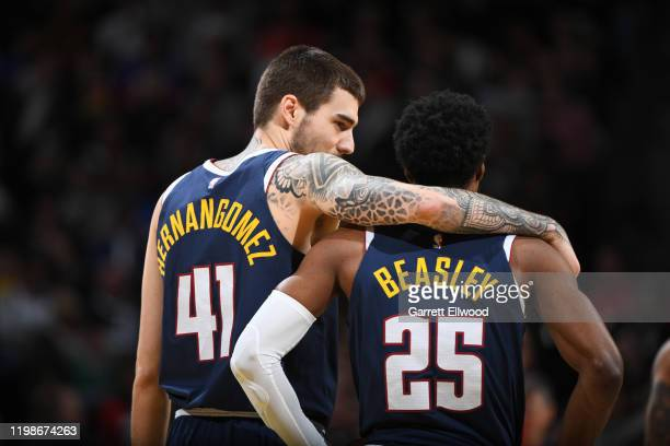Juan Hernangomez of the Denver Nuggets and Malik Beasley of the Denver Nuggets talk during a game against the Portland Trail Blazers on February 4...