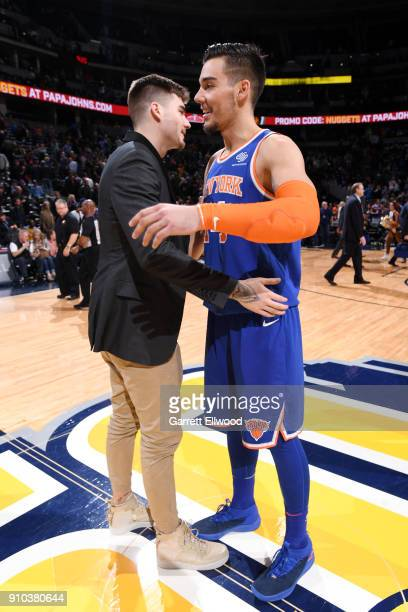 Juan Hernangomez of the Denver Nuggets and Willy Hernangomez of the New York Knicks hug after the game on January 25 2018 at the Pepsi Center in...