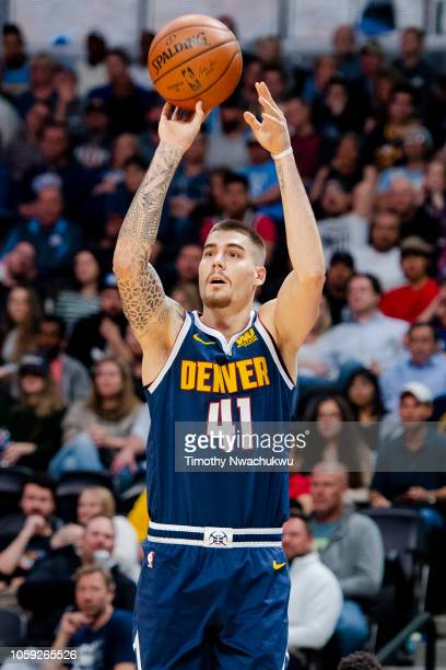 Juan Hernangomez of the Denver Nuggets attempts a three point basket during the second half against the Phoenix Suns at Pepsi Center on October 20...