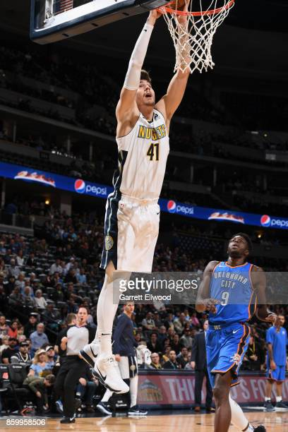 Juan Hernangomez of the Denver Nuggets goes to the basket against the Oklahoma City Thunder on October 10 2017 at the Pepsi Center in Denver Colorado...