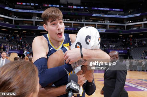 Juan Hernangomez of the Denver Nuggets grabs teammate Gary Harris during an interview after the game against the Sacramento Kings on November 20 2017...