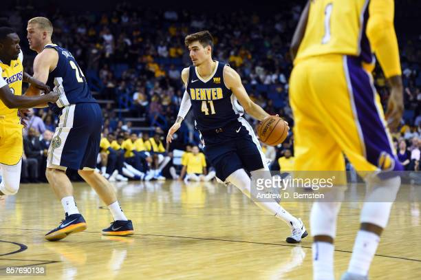 Juan Hernangomez of the Denver Nuggets handles the ball against the Los Angeles Lakers on October 4 2017 at Citizens Business Bank Arena in Los...