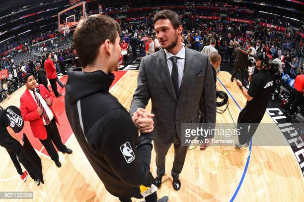 Juan Hernangomez of the Denver Nuggets shakes hands with Danilo Gallinari of the LA Clippers after the game on January 17 2018 at STAPLES Center in...