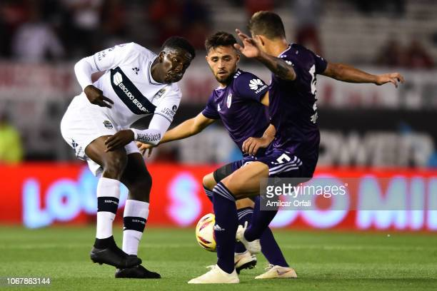 Juan Hurtado of Gimnasia and Bruno Zucculini of River Plate fight for the ball during a match between River Plate and Gimnasia y Esgrima La Plata as...
