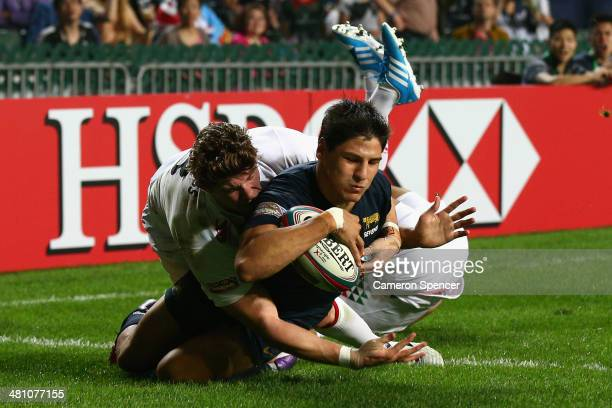 Juan Ignacio Brex of Argentina scores a try during the Pool C match between England and Argentina during day one of the 2014 Hong Kong Sevens at Hong...