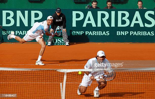 Juan Ignacio Chela and Eduardo Schwank of Argentine in action during the match between Argentina and Kazakhstan for second day in the quarters final...