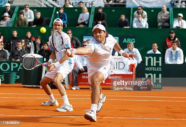 Juan Ignacio Chela and Eduardo Shuank of Argentine in action during the match between Argentina and Kazakhstan for second day in the quarters final...