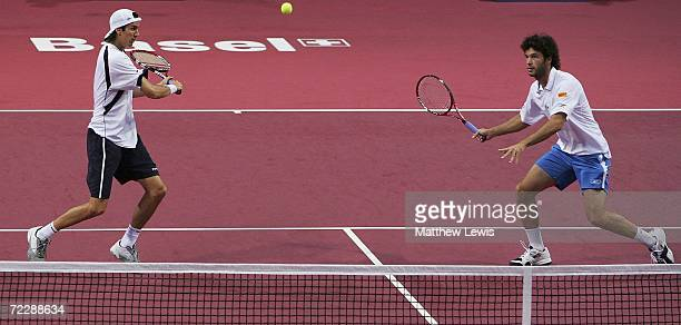 Juan Ignacio Chela and Jose Acasuso of Argentina in action against Mark Knowles of the Bahamas and Daniel Nestor of Canada during day five of the ATP...
