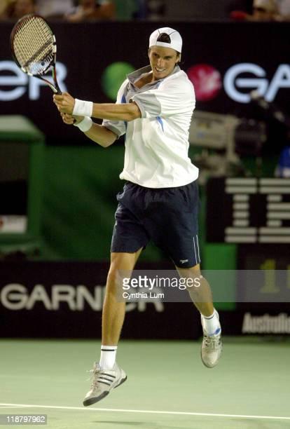 Juan Ignacio Chela hits a backhand Unseeded Juan Ignacio Chela upsets third seed Lleyton Hewitt 64 64 67 63 in the second round of the Australian...