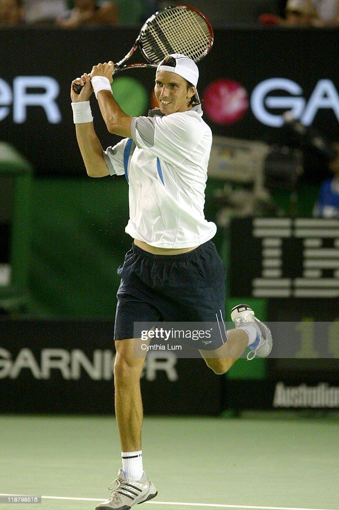 Juan Ignacio Chela hits a forehand. Unseeded Juan Ignacio Chela (ARG) upsets third seed, Lleyton Hewitt (AUS) 6-4, 6-4, 6-7, 6-3 in the second round of the Australian Open, Melbourne Park, Melbourne, Australia.