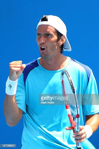 Juan Ignacio Chela of Argentina celebrates a point in his second round match against Pablo Andujar of Spain during day four of the 2012 Australian...