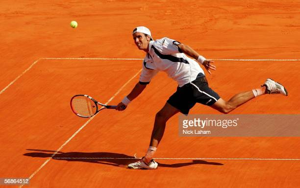 Juan Ignacio Chela of Argentina hits a return against Potito Starace of Italy during the Copa Telmex ATP Buenos Aires February 16, 2006 at the Buenos...