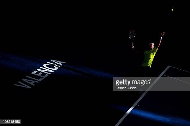 Juan Ignacio Chela of Argentina serves the ball to Nikolay Davydenko of Russia in his second round match during the ATP 500 World Tour Valencia Open...