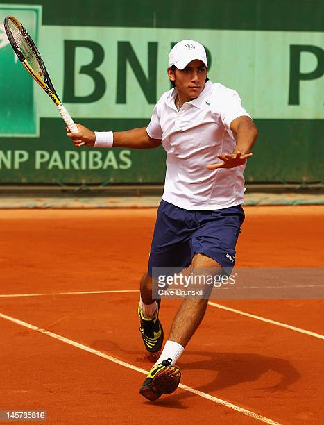 Juan Ignacio Galarza of Argentina in action in the boys doubles first round match between Laslo Djere of Serbia and Pietro Licciardi of Italy and...