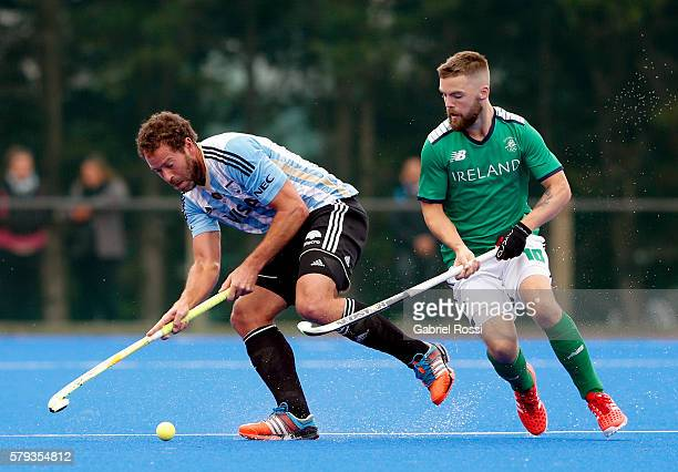 Juan Ignacio Gilardi of Argentina fights for the ball with Alan Sothern of Ireland during an International Friendly match between Argentina and...
