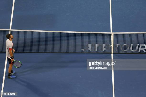 Juan Ignacio Londero looks up at the scoreboard during the Western Southern Open at Lindner Family Tennis Center on August 13th 2019 in Mason Ohio