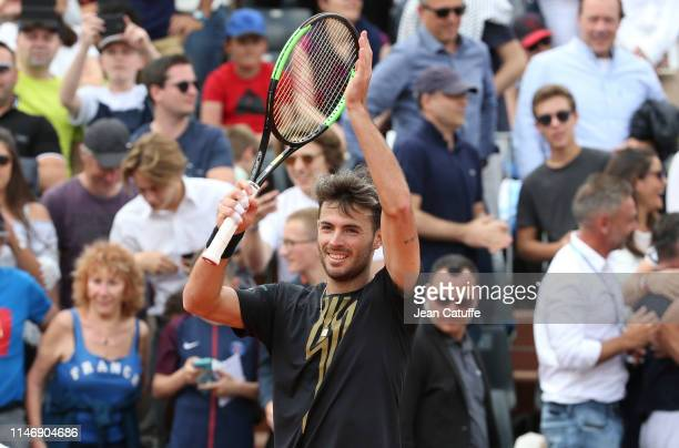 Juan Ignacio Londero of Argentina celebrates his second round match victory against Richard Gasquet of France during day 4 of the 2019 French Open at...