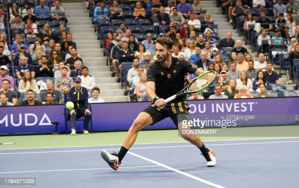 Juan Ignacio Londero of Argentina hits a return against Novak Djokovic of Serbia during the Round Two Men's Singles match at the 2019 US Open at the...