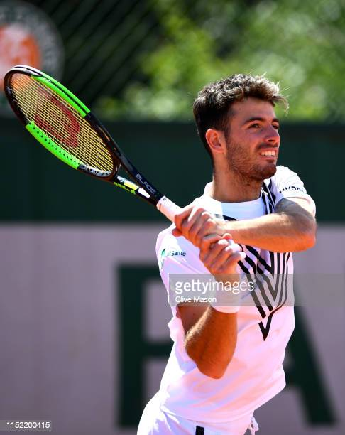Juan Ignacio Londero of Argentina partner of Cristian garin of Chile returns the ball during their mens doubles second round match against JeanJulien...