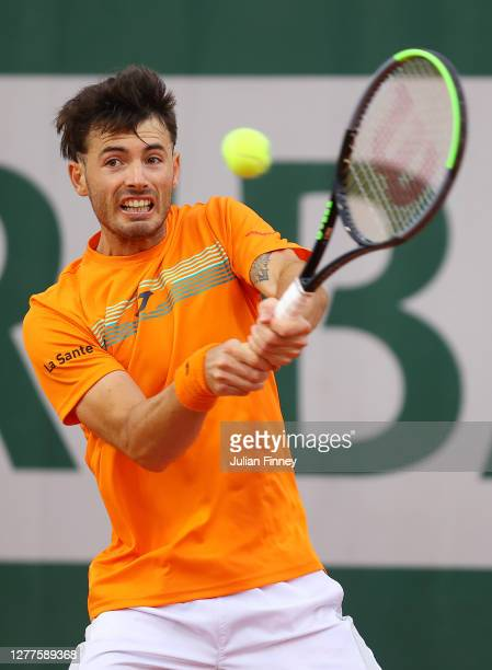 Juan Ignacio Londero of Argentina plays a backhand during his Men's Singles second round match against Marco Cecchinato of Italy on day four of the...