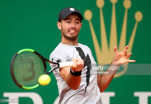 Juan Ignacio Londero of Argentina plays a forehand against Felix AugerAliassime of Canada in their first round match during day 3 of the Rolex...