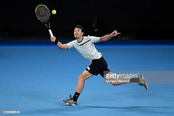 Juan Ignacio Londero of Argentina plays a forehand during his Men's Singles first round match against Grigor Dimitrov of Bulgaria on day one of the...