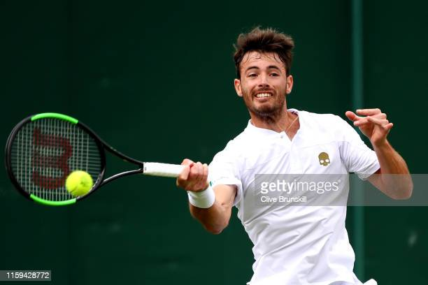 Juan Ignacio Londero of Argentina plays a forehand in his Men's Singles first round match against Benoit Paire of France during Day one of The...
