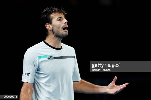 Juan Ignacio Londero of Argentina reacts during his Men's Singles first round match against Grigor Dimitrov of Bulgaria on day one of the 2020...
