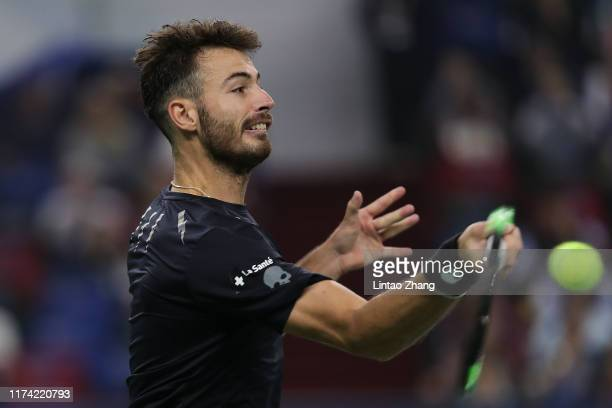 Juan Ignacio Londero of Argentina returns a shot against Andy Murray of Great Britain on Day three of 2019 Rolex Shanghai Masters at Qi Zhong Tennis...