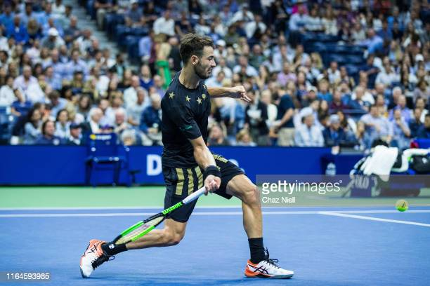 Juan Ignacio Londero of Argentina returns a shot during his Men's Singles second round match Novak Djokovic of Serbia on day three of the 2019 US...