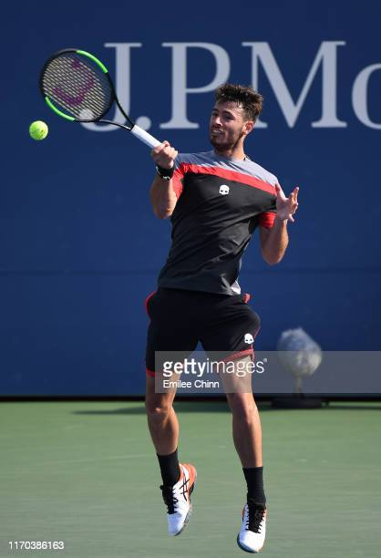 Juan Ignacio Londero of Argentina returns a shot during his men's singles first round match against Sam Querrey of United States during day one of...