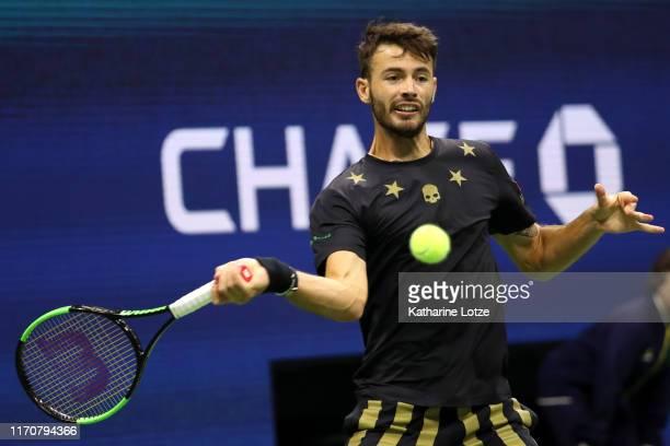 Juan Ignacio Londero of Argentina returns a shot during his Men's Singles second round match against Novak Djokovic of Serbia on day three of the...