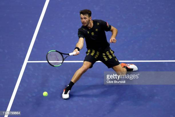 Juan Ignacio Londero of Argentina returns a shot during his Men's Singles second round match against Novak Djokovic of Serbia on day three of the...