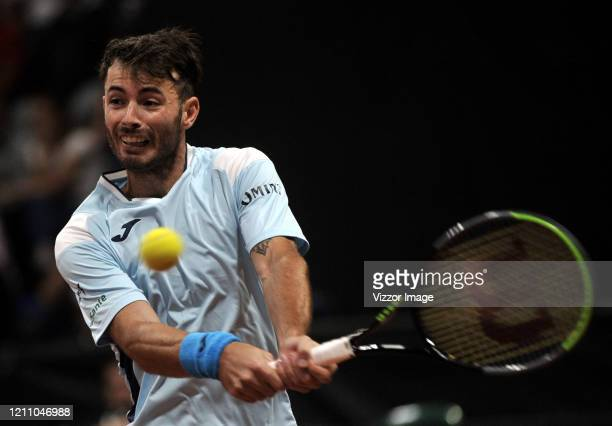Juan Ignacio Londero of Argentina returns the ball to Daniel Galan of Colombia during day 2 of the series between Colombia and Argentina as part of...