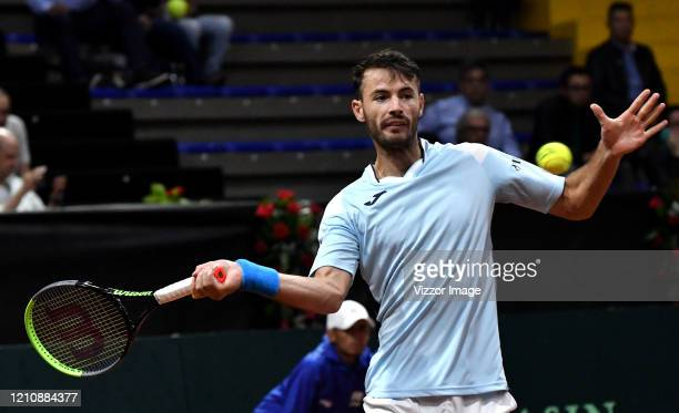 Juan Ignacio Londero of Argentina returns the ball to Santiago Giraldo of Colombia during day 1 of the series between Colombia and Argentina as part...