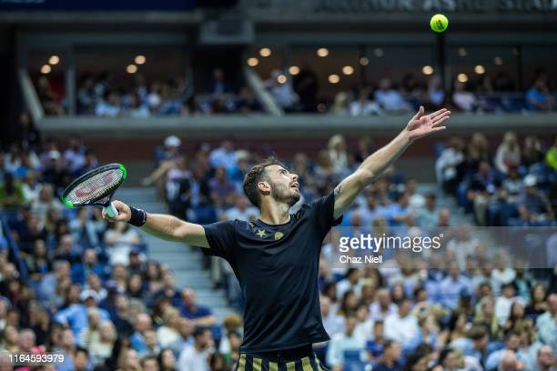 Juan Ignacio Londero of Argentina serves during his Men's Singles second round match Novak Djokovic of Serbia on day three of the 2019 US Open at...