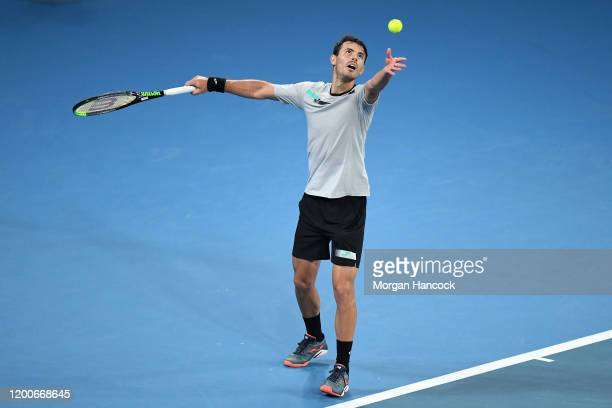 Juan Ignacio Londero of Argentina serves during his Men's Singles first round match against Grigor Dimitrov of Bulgaria on day one of the 2020...