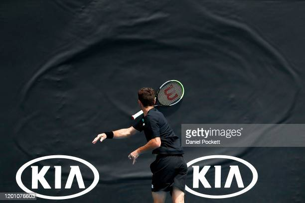 Juan Ignacio Londero of Argentina throws his racquet during his Men's Doubles first round match against Marcelo Arevalo of El Salvador and Jonny...