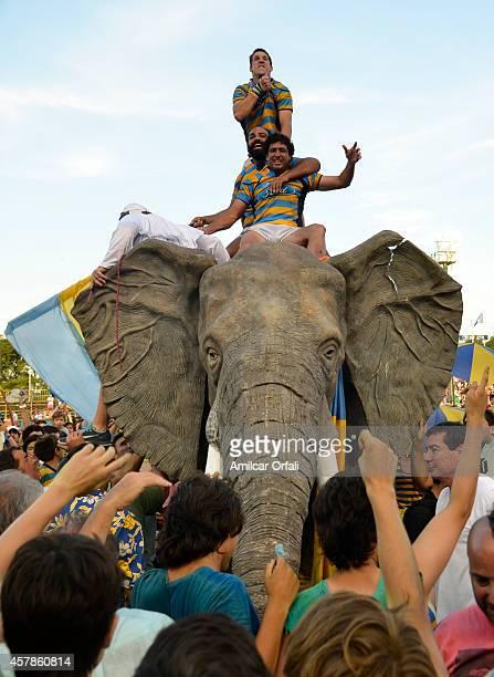 Juan Ignacio Martinez Sosa, Mariano de la Fuente and Lucas Camacho of Hindu Club celebrate riding a plastic elephant after winning a final match...