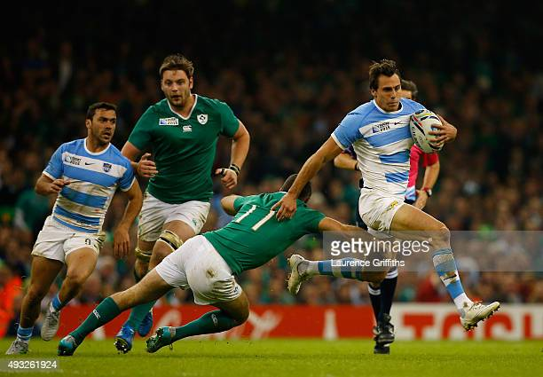 Juan Imhoff of Argentina evades Dave Kearney of Ireland during the 2015 Rugby World Cup Quarter Final match between Ireland and Argentina at...