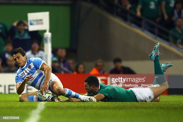 Juan Imhoff of Argentina places the ball down to score the second try during the 2015 Rugby World Cup Quarter Final match between Ireland and...