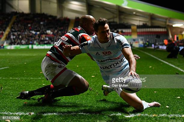 Juan Imhoff of Racing 92 scores his side's second try past JP Pietersen of Leicester Tigers during the European Rugby Champions Cup match between...