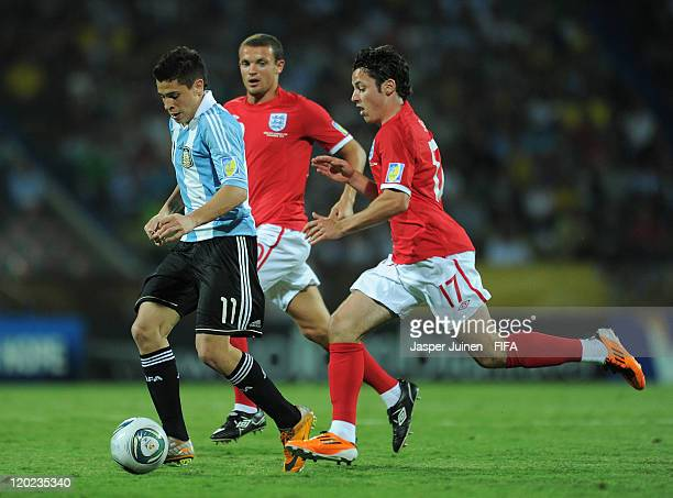 Juan Iturbe of Argentina duels for the ball with Adam Smith of England during the FIFA U20 World Cup Colombia 2011 group F match between Argentina...