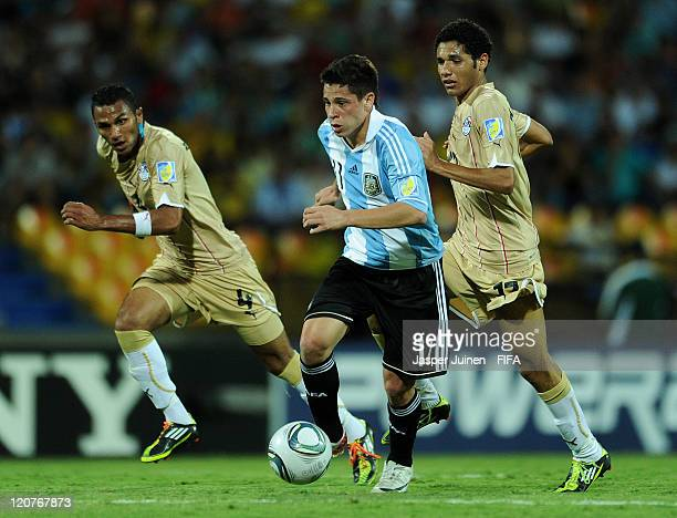 Juan Iturbe of Argentina duels for the ball with Mohamed Abdel and Mohamed El Neny of Egypt during the FIFA U20 World Cup Colombia 2011 round of 16...