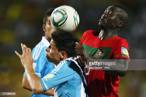 Juan Iturbe of Argentina is challenged by Danilo of Portugal during the FIFA U20 World Cup 2011 quarter final match between Portugal and Argentina at...