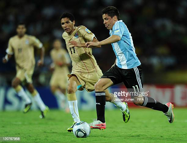 Juan Iturbe of Argentina runs for the ball with Mohamed El Neny of Egypt during the FIFA U20 World Cup Colombia 2011 round of 16 match between...