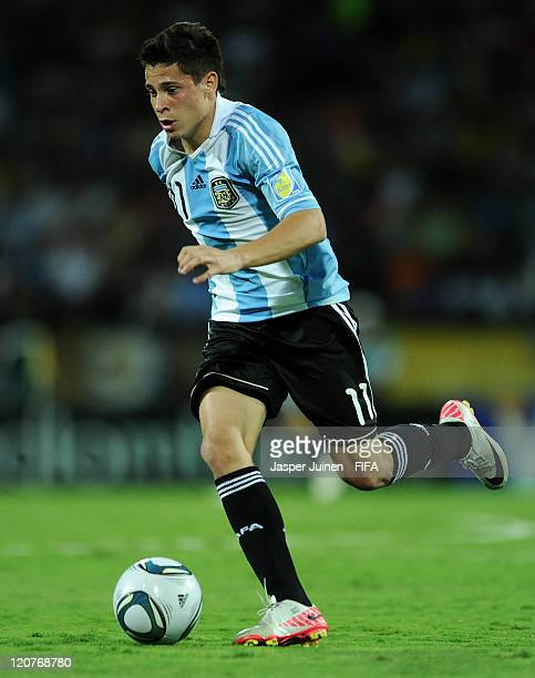 Juan Iturbe of Argentina runs with the ball during the FIFA U20 World Cup Colombia 2011 round of 16 match between Argentina and Egypt at the Atanasio...