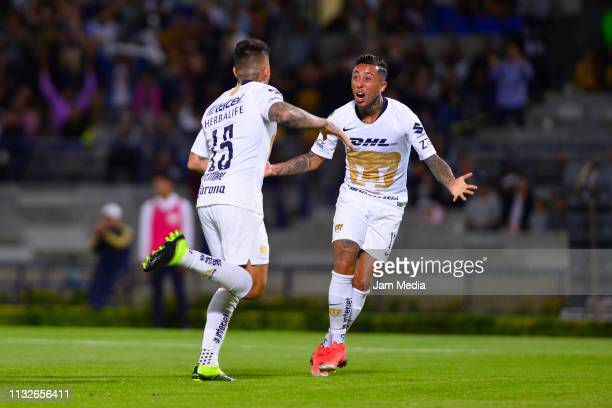 Juan Iturbe of Pumas celebrates after scoring the first goal of his team with teammate Martin Rodriguez during the match between Pumas and Zacatepec...