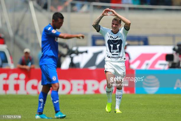 Juan Iturbe of Pumas celebrates after scoring the first goal of his team during the 10th round match between Pumas UNAM and Cruz Azul as part of the...