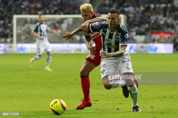 Juan Iturbe of Tijuana and Leonel Vangioni of Monterrey fight for the ball during the third round match between Monterrey and Tijuana as part of...